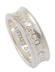 Sale 9029F - Lot 59 - A TIFFANY & CO SILVER 1837 COLLECTION RING; 7mm wide concave ring marked 925 T&CO 1837, inside with registered trade mark 1997, size...