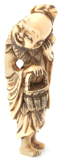 Sale 9140 - Lot 333 - AN ANTIQUE JAPANESE IVORY NETSUKE; depicting a man with basket and monkey on his shoulder, height 7cm.
