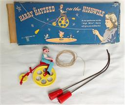 Sale 9142A - Lot 5109 - A rare vintage DCMT Ltd Slikka Toy Harry Hayseed on the Highwire, England c1950: balancing toy in original box, excellent working...
