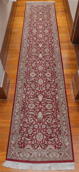 Sale 9260M - Lot 16 - A Persian woolen runner with cream floral bursts over a burgundy ground, 80cm x 395cm