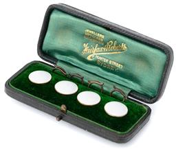 Sale 9149 - Lot 376 - A SET OF ANTIQUE 15CT GOLD ENAMELLED SHIRT STUDS; 14mm round white enamel discs set in 15ct gold, in green velvet lined Fairfax & Ro...