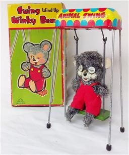 Sale 9142A - Lot 5110 - Vintage Japanese Tin Wind-Up Toy Swing Winky Bear c1960: with original box, good working condition
