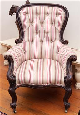 Sale 9190H - Lot 154 - An antique Australian Colonial cedar armchair C: 1860. The button back and shaped seat front upholstered in striped fabric raised on...