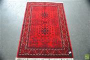 Sale 8291 - Lot 1051 - Afghan Belgic Wool Carpet, with two black octagons on a red field (150 x 100cm)