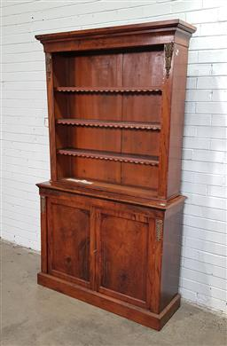 Sale 9162 - Lot 1022 - Victorian figured walnut bookcase, with gilt brass mounts, the open top with adjustable shelves, above two timber panel doors . Key...