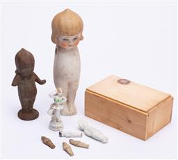 Sale 9185E - Lot 176 - A small cast metal kewpie figure, missing arm together with bisque and other figures