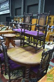 Sale 8326 - Lot 1657 - Dinning Setting inc Circular Oak Extension Table w 2 Leaves Raised on Barley Twist Legs & 8 Heavily Carved Chairs inc 2 Carvers