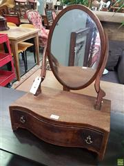 Sale 8598 - Lot 1068 - George III Mahogany Toilet Mirror, the oval mirror on shaped supports, a serpentine shaped base fitted with a drawer (missing one ba...