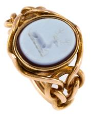 Sale 8899 - Lot 393 - AN 18CT GOLD ANTIQUE HARDSTONE SEAL RING; oval Niccolo (onyx) intaglio of the Hollingworth crest featuring a stag in profile to knot...