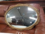 Sale 9051 - Lot 1035 - Ornate Gilt Framed Oval Mirror with a bevelled Edge (86 x 62cm)