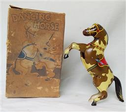 Sale 9142A - Lot 5112 - Dancing Horse Tin Clockwork Toy, c1940 England: with original key and box, good working condition