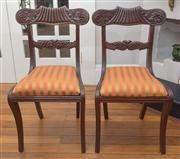 Sale 8470H - Lot 38 - A set of eight Regency mahogany dining chairs including two armchairs with reeded leaf carved rails with reeded frames and sabre leg...