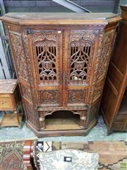 Sale 8634 - Lot 1092 - Good French Oak Gothic Revival Cabinet, of trapeze section, the two pierced tracery doors with armorials & portrait medallions below...