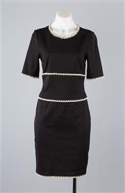 Sale 8740F - Lot 104 - A Thakoon fitted black cotton dress with a contrasting shell patterned trim, size 2