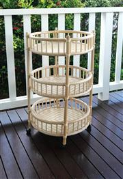 Sale 8858H - Lot 87 - Cane Trolley with Three Tiers, Woven Bases and on Castors, H 84 x D 49 cm -