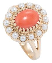 Sale 8999 - Lot 373 - A 9CT GOLD CORAL AND PEARL CLUSTER RING; centring an oval cabochon coral to surround of 14 seed pearls, size N1/2, top 15.9 x 14.5mm...