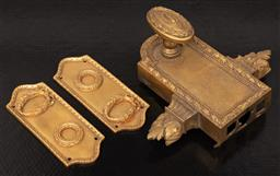 Sale 9130H - Lot 39 - Three items of gilt brass hardwares to include a lock and two door plates in the classical taste.