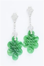 Sale 8338J - Lot 340 - A PAIR OF JADE AND DIAMOND DECO STYLE EARRINGS; carved nephrite jade (dyed) plaques suspended from articulating drops set with a tot...