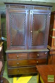 Sale 8520 - Lot 1056 - Regency English Colonial Padouk Press on Chest, with carved frieze, two sunburst panel doors with carved frames enclosing slides, ab...