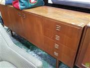 Sale 8566 - Lot 1130 - Teak Three Door Sideboard with Four Drawers