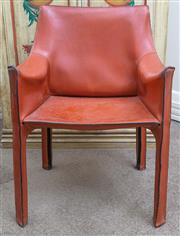 Sale 8800 - Lot 150 - A leather clad armchair of contemporary design in russet, H 82 x W 58 x D 48cm
