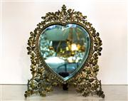 Sale 8516A - Lot 93 - An early continental, hand worked and embossed heart mirror with exceptional detail and bevelled glass. 34cm high x 27cm wide x 14...
