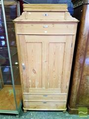 Sale 8539 - Lot 1066 - Antique Style Continental Pine Wardrobe, having a stepped top, four drawers & single door (Key in Office)