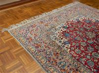 Sale 8735 - Lot 25 - A Cadrys Persian fine woollen Nain carpet with central medallion on a rouge ground, the grey border with blue and orange foliate pa...