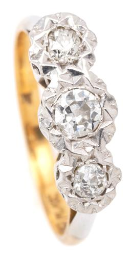 Sale 9132 - Lot 346 - A VINTAGE 18CT GOLD THREE STONE DIAMOND RING; illusion set in platinum with 3 Old European cut diamonds totalling approx. 0.28ct on...