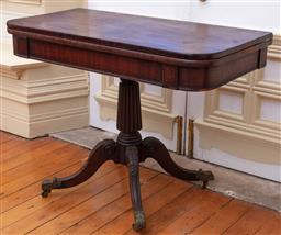 Sale 9190H - Lot 203 - An antique Georgian mahogany swivel top tea table C: 1815. The folding swivel top ebony strung and rosewood cross banded. The frieze...