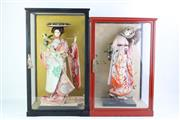Sale 8827D - Lot 92 - A Geisha Doll in Case Together with Another Example (H 49cm x 32cm x 24cm and H 53cm x 24cm x 31cm)