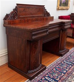 Sale 9190H - Lot 165 - An antique English William IV double pedestal flame panelled mahogany sideboard C: 1835. The back with a flame mahogany tablet centr...