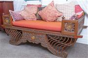 Sale 8800 - Lot 151 - An Indonesian day bed, with floral designs and gilt details, with russet cushions, H 69 x L 160 x D 76cm