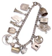 Sale 9074 - Lot 327 - A SILVER CHARM BRACELET; curb loink chain to bolt ring clasp attached with 14 charms in silver and white metal, length 18.5cm, wt. 3...