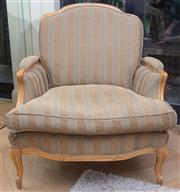 Sale 8568A - Lot 161 - A Louis XV style oversized armchair in an olive green striped fabric, some wear to fabric