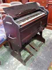 Sale 8617 - Lot 1053 - Late 19th/ Early 20th Travelling Paddle Organ, fitted with note stand & carry handles, having four octaves