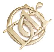 Sale 9054 - Lot 344 - A DIOR MONOGRAM BROOCH; in gilt metal marked Parfums Christian Dior, 52 x 62mm.
