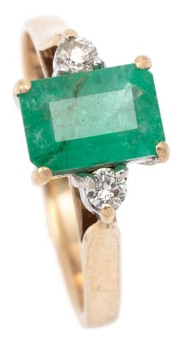 Sale 9132 - Lot 338 - AN EMERALD AND DIAMOND RING; bead claw set in 9ct gold with and an emerald cut emerald of approx. 1ct to shoulders set with 2 round...
