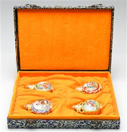 Sale 9190 - Lot 47 - A cased set of four Chinese painted snuff bottles (H:8.5cm to 9.5cm)