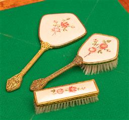 Sale 9260M - Lot 18 - A three piece dressing table set consisting of a mirror and two brushes
