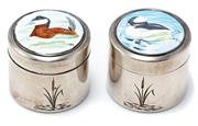 Sale 8905J - Lot 351 - A PAIR OF ENAMELLED SILVER CONTAINERS; cylindrical form each lid features an enamelled duck, 28 x 31mm, hallmarked London 1978, limi...