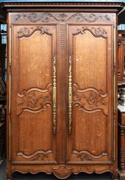 Sale 8942H - Lot 39 - A C19th French carved oak armoire with floral carving and large brass doorplates, Height approx. 237cm x Width 162cm