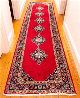 Sale 9150H - Lot 156 - A Persian woollen runner handwoven rug with repeating medallion design, 405cm x 100cm