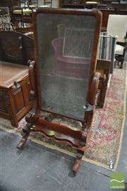 Sale 8317 - Lot 1099 - Early Victorian Mahogany Cheval Mirror on scroll supports with attached brass sconces & on shaped platform base