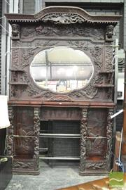 Sale 8345 - Lot 1056 - Rare & Impressive Japanese Export Carved Fireplace Surround, the lobed central mirror flanked by Onis, dogs of foo, a phoenix & shel...