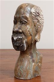 Sale 8868H - Lot 79 - An African carved stone head, Height 22cm