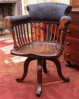 Sale 9190H - Lot 288 - An antique English oak and black leather upholstered swivle desk chair C: 1890. The tub shaped and collared back with reeded staves,...