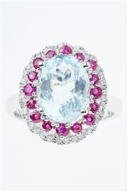Sale 8322J - Lot 329 - AN 18CT WHITE GOLD AQUAMARINE AND GEMSET RING; centring an oval cut aquamarine of 3.17ct to surround of 16 round cut rubies encircle...