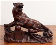 Sale 8868H - Lot 81 - A brown painted ceramic figure of an oriental tiger standing on the Great Wall of China, Length 28cm