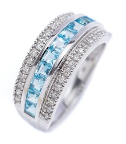 Sale 9194 - Lot 538 - A 9CT WHITE GOLD TOPAZ AND DIAMOND RING, half hoop set with a row of 11 carre cut blue topaz to borders set with 34 single cut diamo...